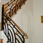Wrought wrought iron interior railing with brass handrail
